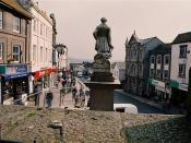 English: Market Jew Street Sir Humphrey Davy turns his back and looks down the main Penzance high street and beyond into distant Carn Brea on the skyline.