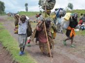 Villagers fleeing gunfire in a camp for internally displaced persons during the 2008 Nord-Kivu war