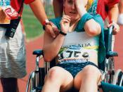 English: Australian athlete Marsha Green is assisted from the track at the 1996 Atlanta Paralympic Games