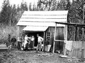 A Tulalip family in front of their home on the reservation in 1916