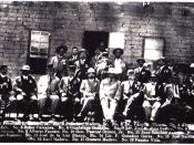 Official photograph of the victors of the Battle of Ciudad Juárez. Madero is seated in center, Orozco on the far right, and Villa is standing on the far left.