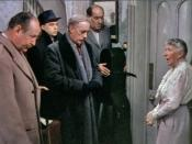 Mrs. Wilberforce (Katie Johnson) lectures the gangsters (from left to right: Cecil Parker as Claude (