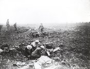 English: Canadian machine gunners dig themselves in, in shell holes on Vimy Ridge. This shows squads of machine gunners operating from shell-craters in support of the infantry on the plateau above the ridge.