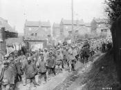 English: German prisoners of war on the march to confinement areas behind the Canadian lines.