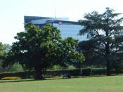 English: Glaxo Smith Kline's HQ building taken from Boston Manor Park.