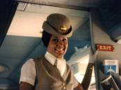 Pan-Am flight attendant on airplane. Photo taken during the summer of 1970