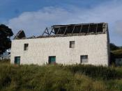 English: Storm damaged byre/barn. This byre/barn belonged to the Poolewe Hotel. Byre downstairs, barn upstairs. Thirty or so years ago the hotel kept seven cows for milk. The roof was blown off during the January storm. The barn is now in the process of b