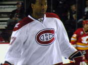 English: Montreal Canadiens forward Georges Laraque during warm-up prior to a National Hockey League game against the Calgary Flames, in Calgary.