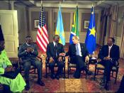George W. Bush meets with Joseph Kabila of the Democratic Republic of Congo, left, Thabo Mbeki of South Africa, center, and Paul Kagame of Rwanda, right, at the Waldorf-Astoria Hotel in New York City.