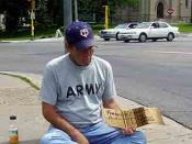 Beggar in front of Walker Art Center, Minneapolis, MN