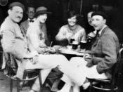 Ernest Hemingway seated in 1925 with the persons depicted in the novel