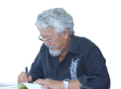 Suzuki signing a copy of his works
