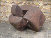 English: Sculpture at corner of Church St and Chiswick Mall, Chiswick, London. Plaque reads: COUPLET / CHARLES HADCOCK 1999 / SPONSORED BY FULLER SMITH AND TURNER.