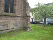 Housman's grave at St. Laurence's Church in Ludlow, Shrophire, England. Note the cherry tree planted in his memory (see A Shropshire Lad, II)