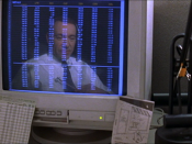 Lester's reflection in the monitor is intended to resemble a man in a jail cell, evoking the director's intended theme of imprisonment and escape from imprisonment.