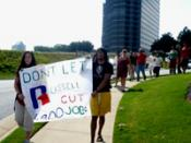 English: Members of United Students Against Sweatshops march outside the offices of Russell Corporation in Atlanta, GA, during a protest against Russell's worker rights violations at its Honduras factories.
