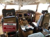 Boeing 777 cockpit, note software update in progress...