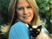 Susan Ford, daughter of US President Gerald Ford, with Shan, the Ford family's Siamese cat.