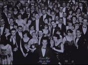 The photograph, captioned Overlook Hotel, July 4th Ball, 1921. A young Jack stands smiling in the bottom center.