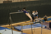 Lake Braddock gymnast on uneven bars at VHSL state