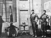 English: A scene from R.U.R., showing three robots.