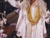 New Orleans Mardi Gras Day 1999. Costumed reveler on balcony on Bourbon Street.