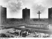 Hindenburg's original 1934 burial at the Tannenberg Memorial. Hitler is speaking at the lectern.