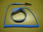 A cheap antistatic wrist strap with crocodile clip.