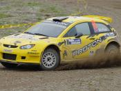 English: Proton Satria Neo Super 2000 rally car drived by Alister McRae in Rally Hokkaido 2010 日本語: プロトン・サトリアネオ Super 2000、ドライバーはアリスター・マクレー、ラリー北海道2010にて