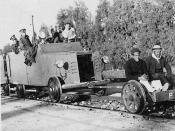 English: A British armored railroad wagon behind a railcar on which two Arab hostages are seated, 1936-1939 Arab Revolt