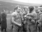 Frank Dombrowski (left) of the United States and Captain W. Drinkwater of Canada, rival captains... / Frank Dombrowski (à gauche) des États-Unis et le capitaine W. Drinkwater du Canada, les capitaines des équipes rivales...