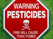 English: A sign warning about pesticide exposure.