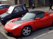 English: A Tesla Roadster, Reva i and Ford Th!nk electric cars parked at a free parking and charging station near Akershus fortress in Oslo, Norway