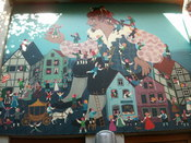 English: This picture has been made to a mural at the facade of a toy-shop in Bremen, Germany. Español: Esta foto es de un mural en la fachada de una tienda de juguetes en Bremen, Alemania.