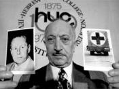 Nazi hunter Simon Wiesenthal holding a picture of Nazi war criminal, Walter Rauff, in May 1973.