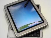 Photo of HP Tablet PC running MS Windows Tablet Edition. Modified with Picasa2.