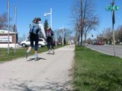 English: University of North Dakota youth rollerblading in front of Medical School building.