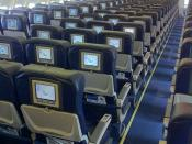 English: Economy class cabin interior of a Thomas Cook Airlines Airbus A330.