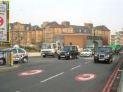 In London, street markings and a sign (inset) with the white-on-red C alert drivers to the charge.