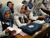 Student from the Hala Bint Khuwaylid secondary girl's school in the Amil district of Baghdad with their new school bags which contains, pens, pencils, notebooks, a calculator and other school supplies. USAID is funding the purchase and distribution of 1.5