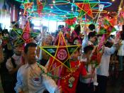 en: Vietnamese children celebrating Mid-Autumn Festival in a traditional lantern procession.
