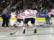 English: The Canadian and Finnish junior teams face off during an exhibition game in Calgary, Alberta.