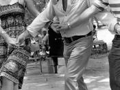 Secretary of State George Firestone (center), Florida Folklife Program director Phillip A. Werndli and Patti Schutt dancing with the Drava Folkdance Ensemble at the 1980 Florida Folk Festival: White Springs, Florida
