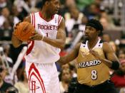 of the Houston Rockets, being guarded by of the Washington Wizards