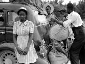 English: African American migrant workers from Florida on their way to harvest potatoes in Cranbury, New Jersey. The photograph was taken near Shawboro, North Carolina.