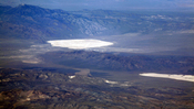 Groom Lake and Papoose Lake, both in the Nevada Test and Training Range. Groom Lake is also in Area 51. Note that some of the lines you see beside Groom lake are among the longest runways on Earth.