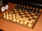 Chess game and play clock with the pieces in their initial position.