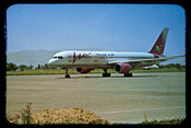 English: Airplane belonging to Tajik Air sitting on an airfield, presumably Dushanbe Airport.