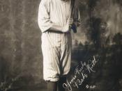 Babe Ruth, full-length portrait, standing, facing slightly right, in baseball uniform, holding baseball bat. Facsimile signature on image: