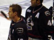 Vancouver Canucks linemates Markus Naslund and Todd Bertuzzi in the 2005–06 season opener.